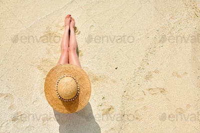 Woman sitting on beach view from above