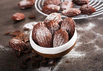 Chocolate cookies. Homemade Chocolate Madeleines on dark table. French cuisine.