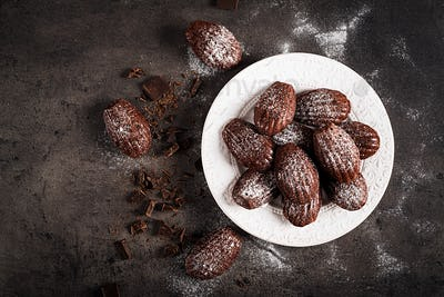Chocolate cookies. Homemade Chocolate Madeleines on dark table. French cuisine. Top view
