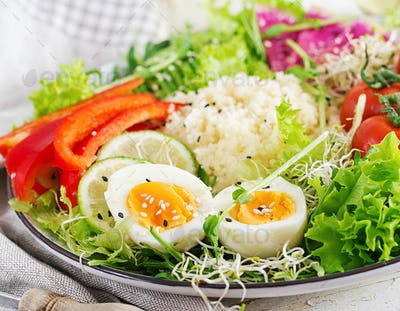 Couscous, egg and vegetables bowl. Healthy, diet, vegetarian food concept.  Vegetarian buddha bowl.