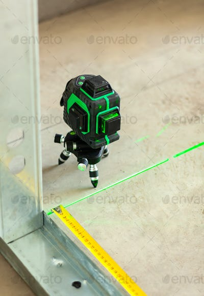 Laser level measuring tool in construction site.