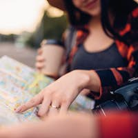 Tourists study the map of city attractions