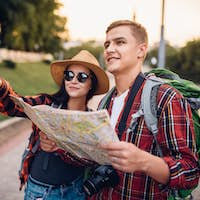 Hikers looking for city attractions on the map