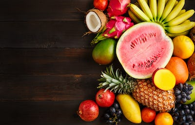 Exotic fruit on a wooden background with copy space