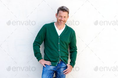 Confident older man smiling isolated on white background