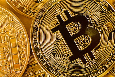 Top view closeup photo of gold bitcoins in a pile