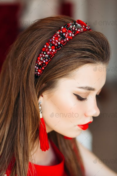 Above view of brunette girl wearing in shiny red hand band