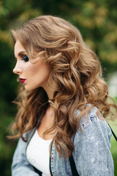Beautiful and seductive woman with perfect makeup and hairstyle
