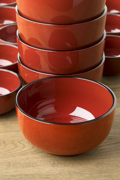Stack of traditional red lacquered Japanese bowls