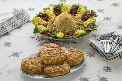 Dish with traditional Moroccan mixed salad and mini bastella