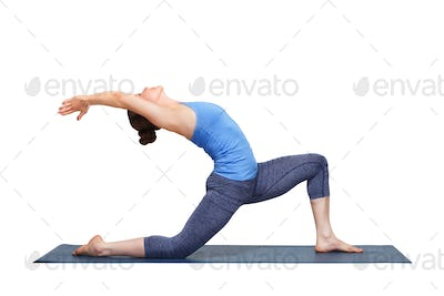 Fit yogini woman practices yoga asana Anjaneyasana