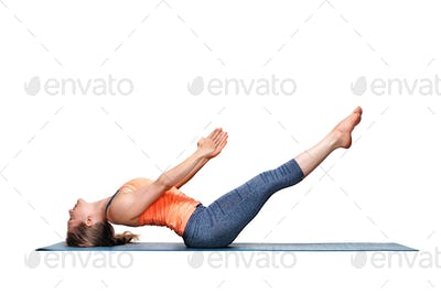 Sporty fit woman practices yoga asana Uttana padasana