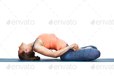 Beautiful sporty fit yogi girl practices yoga asana Matsyasana