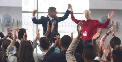 Business people applauding and celebrating business executives at business seminar