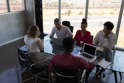 Diverse business colleagues looking concentrated while working together in modern office