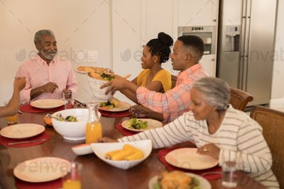 Family having meal together on dining table at home