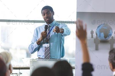 Businessman speaker speaking in business seminar in modern office building