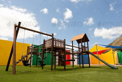 Low angle view of an empty school playground on a sunny day