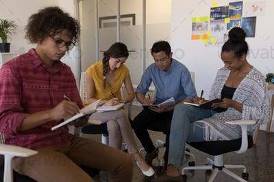 Business colleagues looking concentrated in modern office