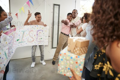 Senior black couple arriving home to a family surprise party, selective focus