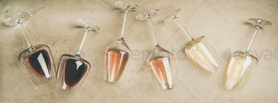 Different wines in glasses and corkscrews, top view
