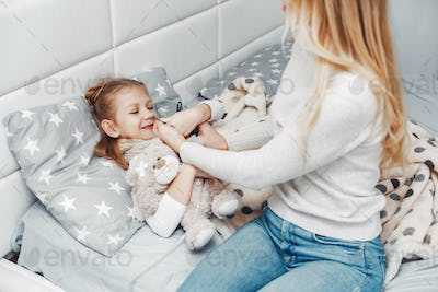 Mother with her illnes daughter in a bedroom