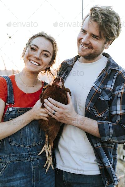 Couple volunteering at an animal sanctuary