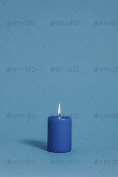Blue candle on blue