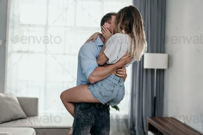 Young beautiful romantic couple kissing