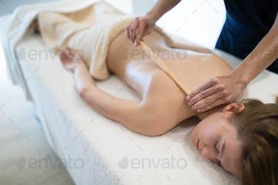 Thai massage therapist treating patient
