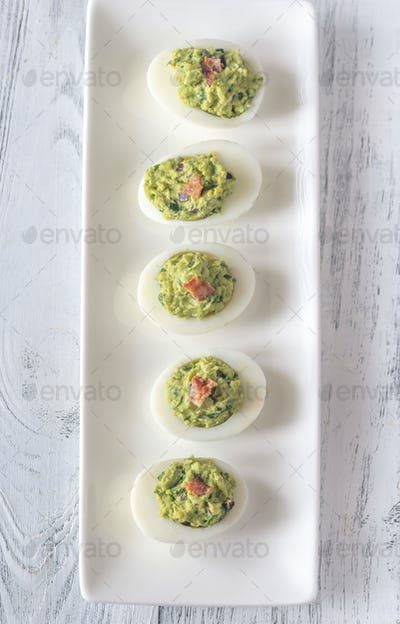 Guacamole and bacon deviled eggs