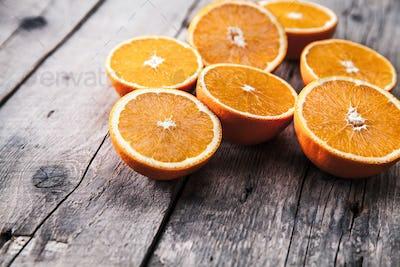 fresh, oranges on a wooden background