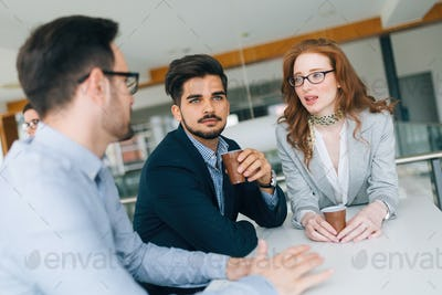 Business colleagues having conversation during coffee break