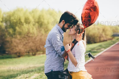 young couple hugging dating and kissing outdoor