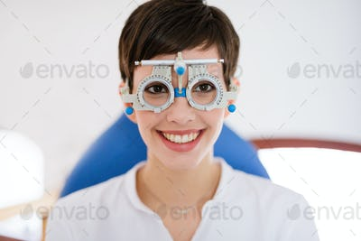 Woman doing eye test with optometrist in medical center