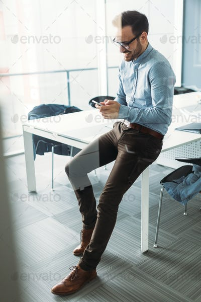 Handsome businessman in contemporary office building