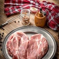 Slices of raw pork neck.