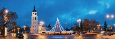 Vilnius, Lithuania. Christmas Tree On Background Bell Tower Belf