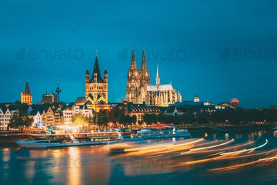 Great St. Martin Church And Dom In Cologne At Evening With Refle