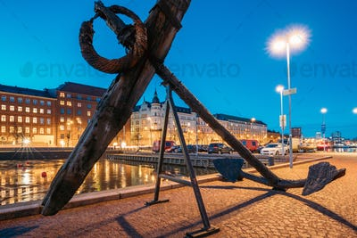 Helsinki, Finland. Old Anchor On Pier With View Of Pohjoisranta