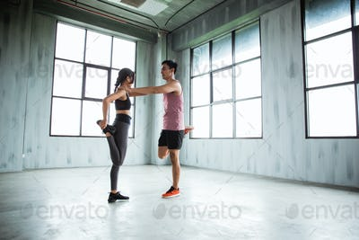 sports couple warming up before to core exercise