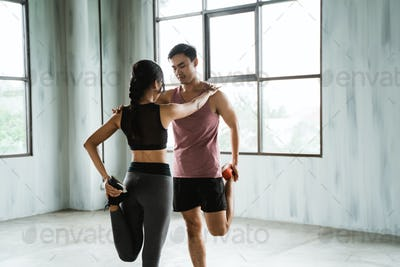 woman and man warming up before workout
