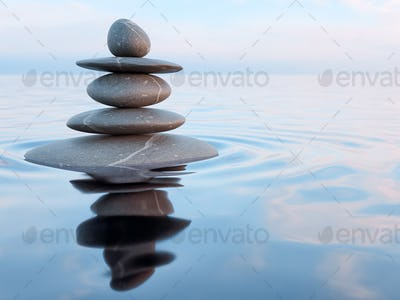 Balanced Zen stones in water