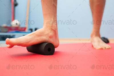 Foam roller plantar fascia treatment in physiotherapy studio