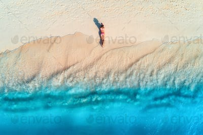 Aerial view of the back of sexy woman on the sandy beach