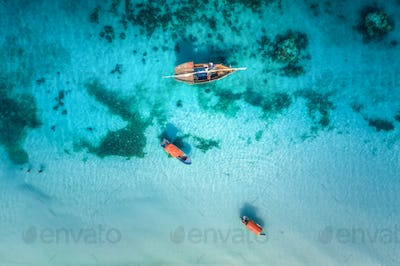 Aerial view of the fishing boats in clear blue water