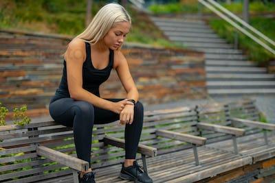 Fitness runner on mobile smart phone app tracking progress for motivation