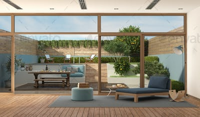 Modern living room with garden on background