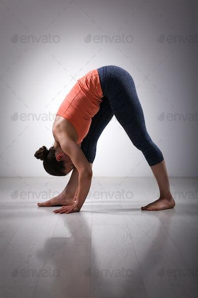 Woman stretching in Ashtanga Vinyasa yoga asana