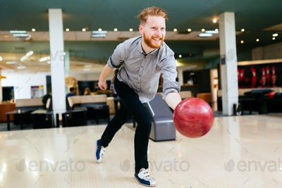 Handsome man bowling